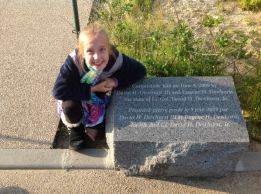 Carolyn Dewhurst with the cornerstone laid at Utah Beach to honor David's dad